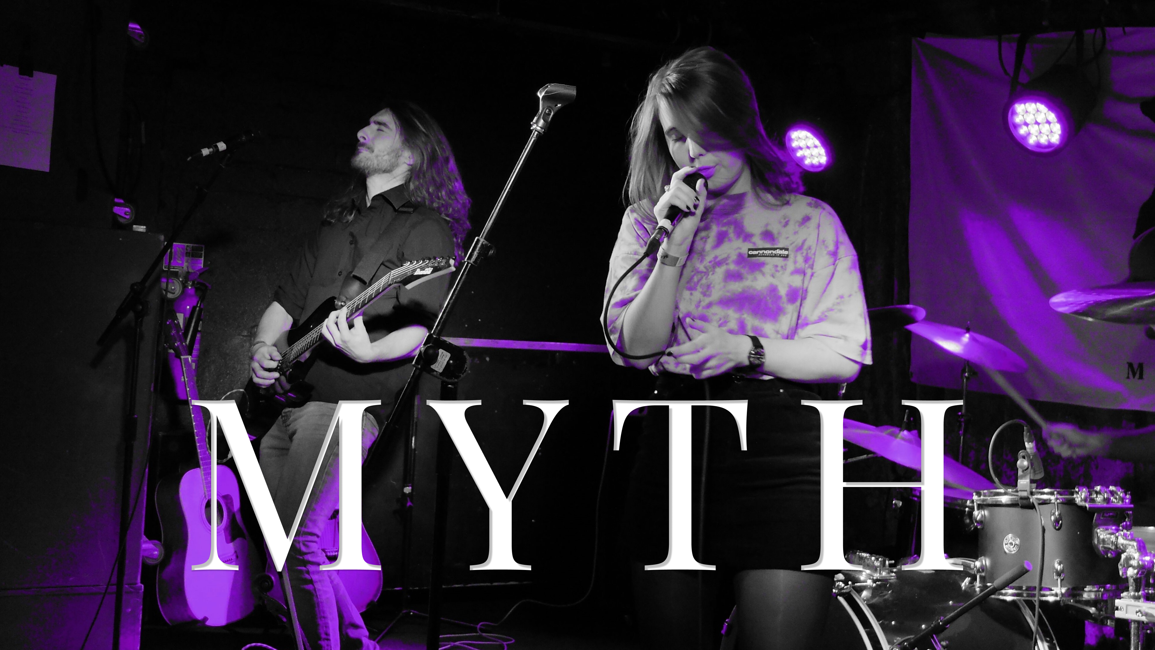 Myth band performing on stage